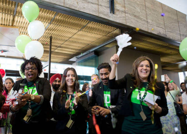 "TD employees greet customers with a surprise thank-you appreciation event and hand out a green envelope containing $20 to each customer - a small gift to say ""Thank You."" (CNW Group/TD Canada Trust)"