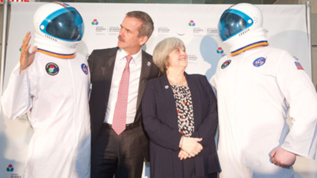 "Ground control to Col. Hadfield! The retired Canadian astronaut was at the Ontario Science Centre today to dedicate the ""To Be An Astronaut"" exhibit, which features a number of his personal effects, including a NASA flight suit, to former CEO Lesley Lewis, who championed science education during her 16-year tenure. (Photo Credit: Ontario Science Centre) (CNW Group/Ontario Science Centre)"