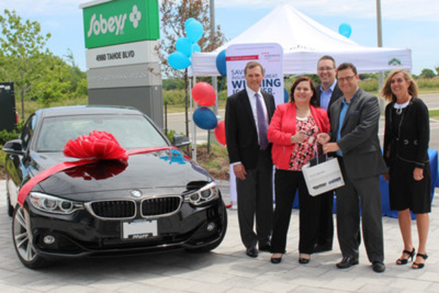 Adriana Thimi (second from left), bakery manager at the Rosebury Square Sobeys in North York, receives the keys to a shiny new 2016 BMW 428i from David Fitzpatrick of Economical Select, Jamie Reid of A.P. Reid Insurance (second from right) and Trevor Bartlett (centre) and Beth Newlands Campbell (right) of Sobeys. She won the car in the Select Sweepstakes campaign simply for calling her group insurance broker, A.P. Reid, for a quote. (CNW Group/Economical Insurance)