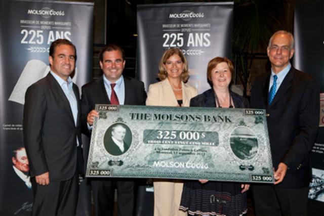 Brothers Geoff and Andrew Molson and Monique Dépatie, Community Relations Manager, officially presenting a cheque commemorating the Molson Bank founded in 1855, to Francine Lelièvre, Executive Director of Pointe-à-Callière and Daniel Desjardins, Senior VP, Legal Affairs with Bombardier and Vice-Chairman of the Board of Directors of Pointe-à-Callière Foundation (CNW Group/MOLSON COORS CANADA)