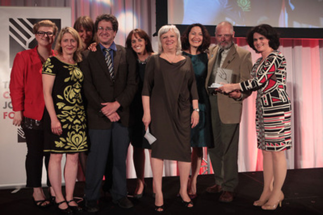 Anna Maria Tremonti (third from right), host of CBC Radio One's The Current, along with executive producer Pam Bertrand (fourth from right) and the program staff accept the Canadian Journalism Foundation Excellence in Journalism Award for the large media category from Antonia Maioni (far right), associate professor at McGill University in the Department of Political Science and the Institute for Health and Social Policy. (CNW Group/Canadian Journalism Foundation)