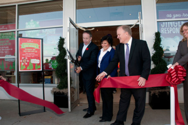 The Honorable Maurizio Bevilacqua, mayor of Vaughan, and Ward 3 Councillor Rosanna DeFrancesca help Chris Kelly, VP Consumer Solutions & Brand Experience, Hallmark Canada, officially unveil the newly re-designed Hallmark Gold Crown Store in Woodbridge, Ontario. The store provides customers with a fun and inspiring shopping experience to help them connect with loved ones. (CNW Group/Hallmark Canada)