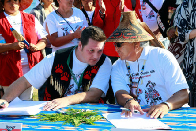 Chief Justin George of Tsleil-Waututh Nation and Chief Gibby Jacob of Squamish Nation sign a historic declaration to protect the Salish Sea. (CNW Group/Tsleil-Waututh Nation)