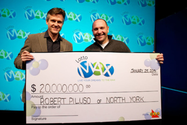 Ontario Lottery and Gaming Corp. President and CEO Rod Phillips presents a $20 million LOTTO MAX cheque to Robert Piluso of Toronto at the OLG Prize Centre on Friday, January 25th, 2013. (Photo Credit: Shan Qiao) (CNW Group/OLG)