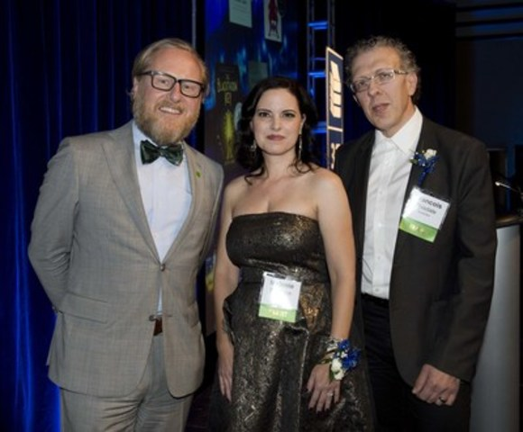 Alec Morley, Senior Vice President, TD Bank Group presents Toronto author Melanie Florence and Quebec-based illustrator François Thisdale with the TD Canadian Children's Literature Award and $30,000 prize for their novel Missing Nimâmâ at an award gala in Toronto. (CNW Group/TD Bank Group)