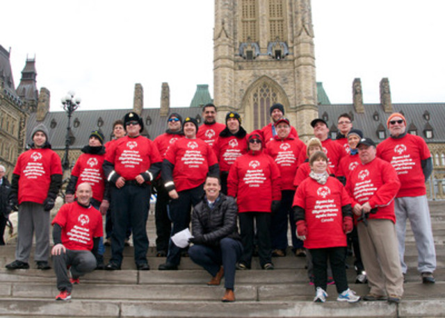 Special Olympics athletes pose with Senator Jim Munson, Minister of Sport Bal Gosal, MP Ryan Leef and Olympic Gold Medalist and Special Olympics Canada board member Mark Tewksbury on Parliament Hill, before participating in the Special Olympics Amazing Race. Photo by Glyn Davies (CNW Group/Special Olympics Canada)