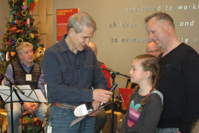 World Vision Canada President Dave Toycen, speaks with Toronto resident Madeline Carmichael, 10, about a class project to choose and donate World Vision Gifts items to help children in poverty. (CNW Group/World Vision Canada)