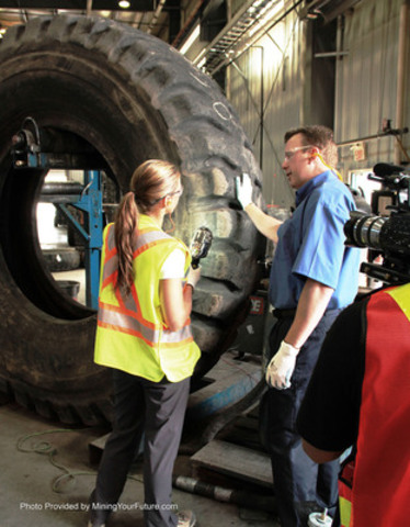 """Mining Your Future"" host Maggie, job shadowing a tire technician at Kaltire, who is working with tires that run over $100,000 EACH. (CNW Group/Mining Your Future)"