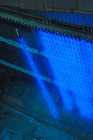 This is a photo of Cobalt-60 after it has been harvested from Bruce Power's Bruce B reactors during planned maintenance outages. It is then shipped to Nordion in Ottawa for processing. The blue glow of the Cobalt-60 is called the 'Cherenkov Effect' and is a result of gamma radiation travelling through water faster than the speed of light travelling through water. When that occurs, photons are released, which creates the blue light. The Cobalt-60 is stored in water in our Secondary Fuel Bay until transported for processing. Cobalt-60 is also used to sterilize 40 per cent of the world's single-use medical devices like syringes, sutures, and surgical gowns, masks and gloves. (CNW Group/Bruce Power)