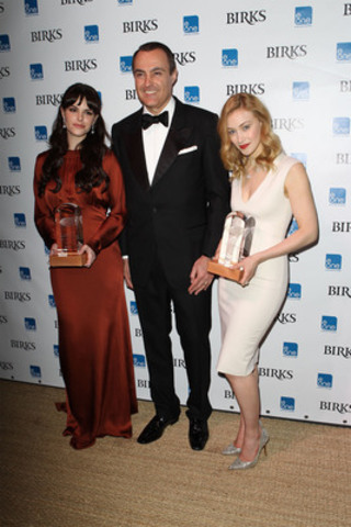 The Birks Canadian Diamond's first recipients, actresses Emily Hampshire and Sarah Gadon, received their award from Jean-Christophe Bedos, President & CEO of Birks, during Telefilm Canada's inaugural Tribute To Canadian Talent press event and reception last night in Cannes. (CNW Group/BIRKS & MAYORS INC.)