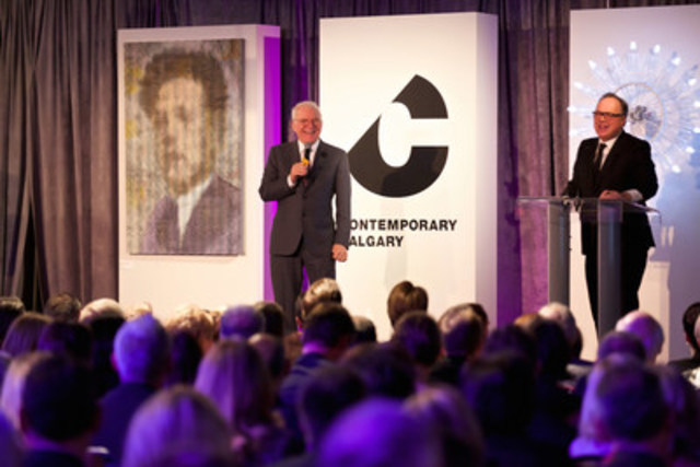 Entertainment legend Steve Martin assists auctioneer Stephen Ranger (Waddington's) to auction a Chris Cran piece (pictured left) at LOOK2016, Contemporary Calgary's premier fundraiser, on October 22, 2016. A piece by artist Diane Landry is also pictured, behind Ranger. (CNW Group/Contemporary Calgary)
