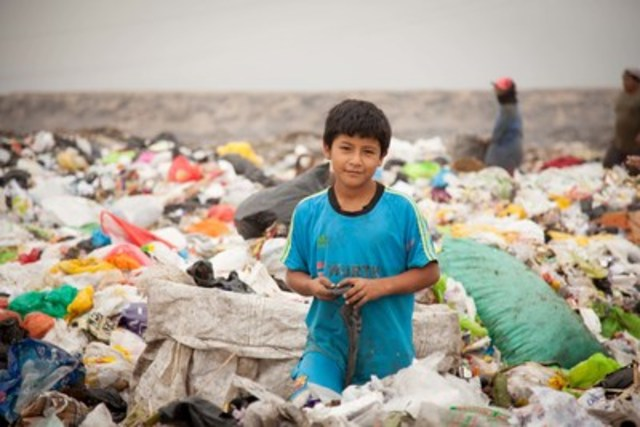 Eleven-year-old Oscar's family can't afford to send him to school, instead he walks two hours to the garbage dump to look for cardboard, scrap metal and cans to recycle to help support his family. (CNW Group/World Vision Canada)