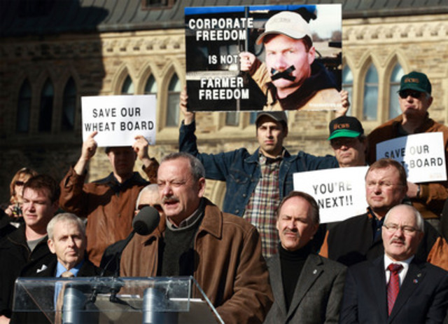 Allen Oberg, Chair of the Canadian Wheat Board, joined by Canadian farmers and opposition MPs, speaks out on Parliament Hill in support of the Canadian Wheat Board. Photo by Jana Chytilova for CNW. Narrative Advocacy PR for the Canadian Wheat Board (CNW Group/CANADIAN WHEAT BOARD)
