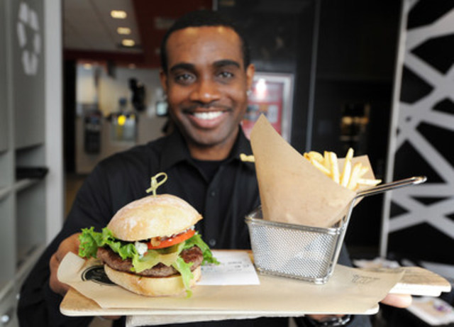 McDonald's Team Leader Troy Eustace delivers a custom built Create Your Taste™ burger. A total of 24 restaurants across Saskatchewan now feature the gourmet burger creation system, which includes table delivery service, and Guest Experience Leaders. (CNW Group/McDonald's Canada)