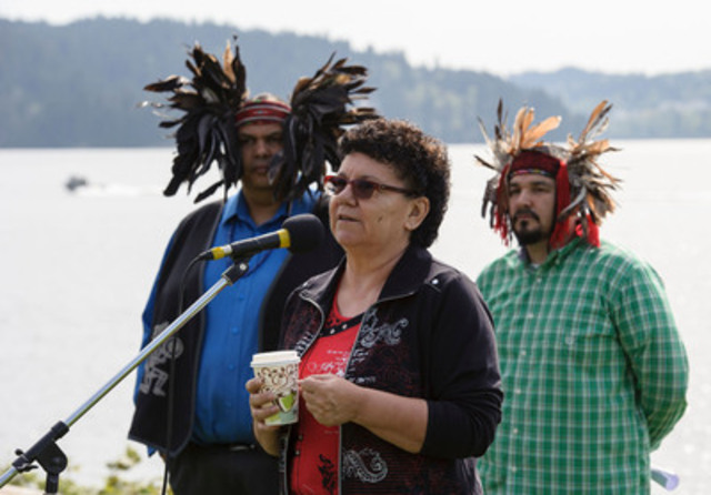 L to R Rueben George, Chief Maureen Thomas and Gabriel George Chief Maureen Thomas of the Tsleil-Waututh Nation announces a legal challenge of the Kinder Morgan Pipeline and Tankers Project Whey-ah-Wichen\Cates Park. (CNW Group/Tsleil-Waututh Nation)