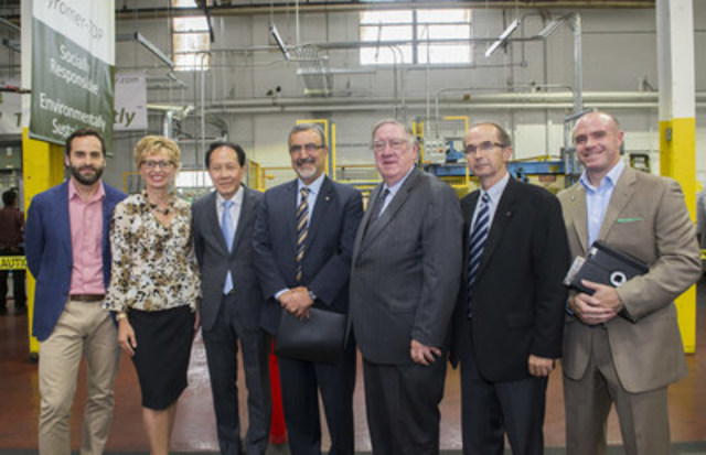 Dignitaries at this morning's Tyromer Open House pose in front of the facility (CNW Group/Ontario Tire ...