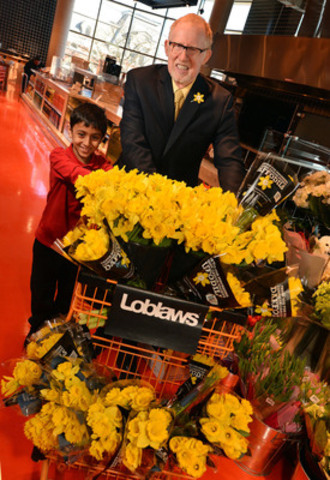 Cancer survivor Mutasim Khandakar, 8, and Martin Kabat, CEO for the Canadian Cancer Society, Ontario Division, kick-off Daffodil Month fundraising. This year, through a partnership with Loblaw Companies Limited, more than one million live daffodils will be sold on behalf of the charity exclusively at Loblaws(R), Zehrs(R), Valu-mart(R), Real Canadian Superstore(R) and Your Independent Grocer(R) stores across Ontario. (CNW Group/Canadian Cancer Society (Ontario Division))