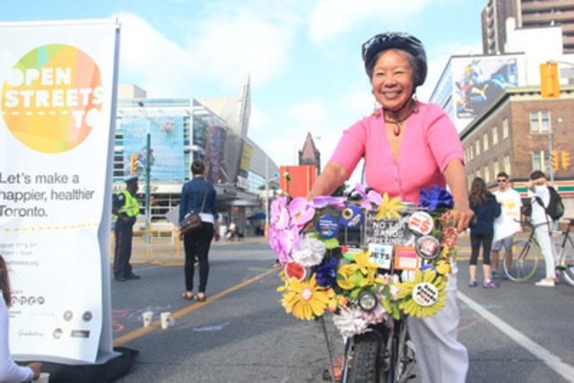 Happy Torontonian cycling at Open Streets TO in 2014. Photo Credit: Wanda Wang (CNW Group/Open Streets TO)