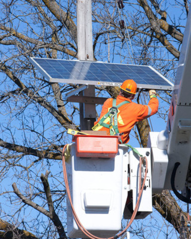 Halton Hills Hydro power line technician Hessel Faber connects one of the utility's new solar-smart grid ...