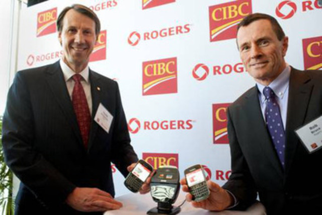 CIBC and Rogers Unveil the Future of Mobile Payments in Canada - David Williamson, Senior Executive Vice President and Group Head, Retail & Business Banking, CIBC and Rob Bruce, President of Communications, Rogers Communications showcase the first mobile payment solution, allowing Canadians to pay with their CIBC credit card at the checkout counter using their Rogers smartphone. (CNW Group/CIBC)