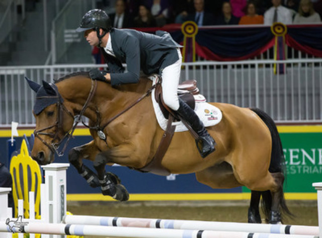 Jonathon Millar of Perth, ON, rode Bonzay to third place in the opening round of the $100,000 Greenhawk Canadian Show Jumping Championship. Photo by Ben Radvanyi Photography (CNW Group/Royal Agricultural Winter Fair)