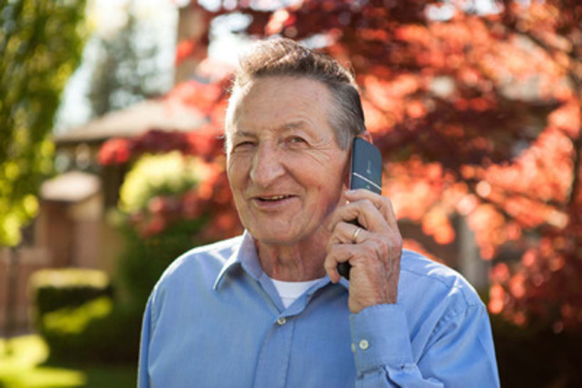 Walter takes a congratulatory call after learning he has been named Doro's Canadian Father of the Year. (CNW Group/Doro)