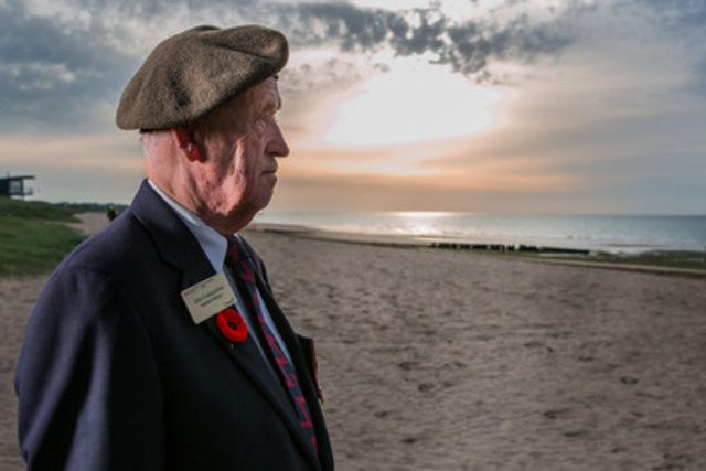Veteran Jack Commerford of Ottawa surveys a much calmer Juno Beach than it was 70 years ago on this day. Mr. Commerford was a gunner with the Heavy Anti-Aircraft Artillery Regiment on D-Day and during the Battle of Normandy. (CNW Group/Veterans Affairs Canada)