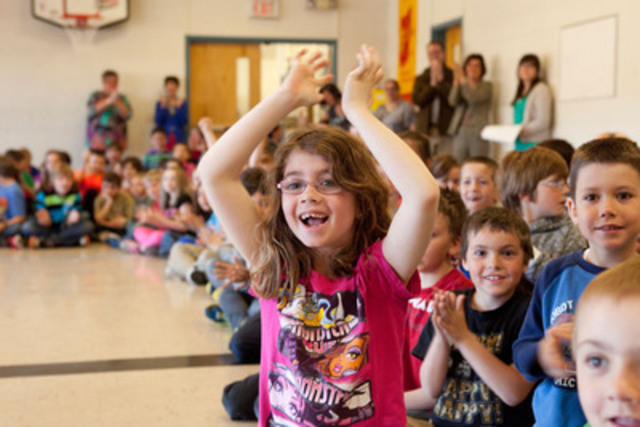 Florenceville Elementary School student Madison Bell reacts to having won a computer lab worth $25,000 in the Staples Canada Recycle for Education Computer Lab Contest. (CNW Group/Staples Canada Inc.)