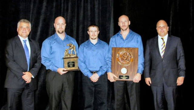 Alexander Proudfoot's Ken Kirk and Paul Hebert with the winning team from Walter Energy's Jim Walter Resources Blue Creek at the National Coal Mine Rescue, First Aid, Bench and Pre-Shift Competition celebrated in September in Columbus, Ohio. (CNW Group/Alexander Proudfoot)