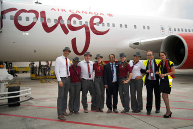 Air Canada rouge Lisbon 3 - rouge crew, Vijay Bathija (center - Air Canada rouge Vice President of Commercial), David Gegot (second from right - Air Canada General Manager for France, Spain & Portugal) and Helena Lobo (far right - Lisbon Sales Agent, AVIAREPS) in front of the first Air Canada rouge Boeing 767-300ER to land in Lisbon (CNW Group/Air Canada rouge)