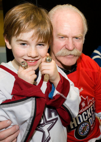 NHL legend Lanny McDonald lends his Stanley Cup rings to Noah Olauson, 7, as excitement builds in Peterborough for Scotiabank Hockey Day in Canada. (CNW Group/Scotiabank - Sponsorships & Donations)