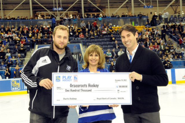 RBC Play Hockey Charity Challenge raises $100,000 for grassroots hockey - cheque presentation with Ryerson Men's Varsity Hockey Captain Andrew Buck (left), RBC's Jane Broderick and Mathieu Schneider of the NHLPA. (CNW Group/RBC)