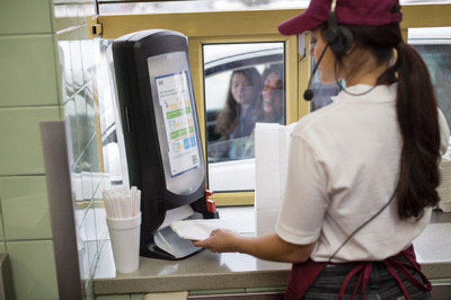 Tork Xpressnap Drive Thru Napkin Dispenser is made specifically for restaurant drive thru windows and dispenses set quantities of napkins with the touch of a button to provide a controlled number of napkins with each order (CNW Group/SCA)