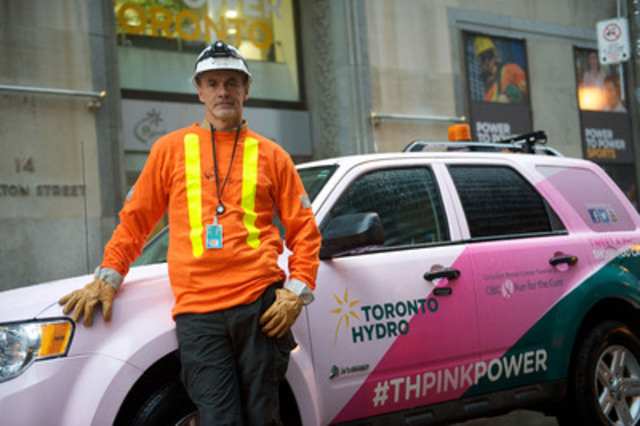 Real men wear pink - at least Mike Carnegie thinks so. Carnegie, a Construction and Maintenance Supervisor, stands proudly in front of one of Toronto Hydro's vehicles wrapped in pink to raise awareness of Breast Cancer. He lost his wife Sharon, 17 years ago to inflammatory breast cancer. (CNW Group/Toronto Hydro Corporation)