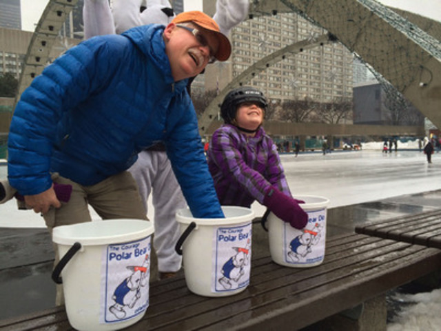 Father and daughter share a chilly moment during the Courage Polar Bear Dip freeze test  (CNW Group/The Courage Polar Bear Dip)