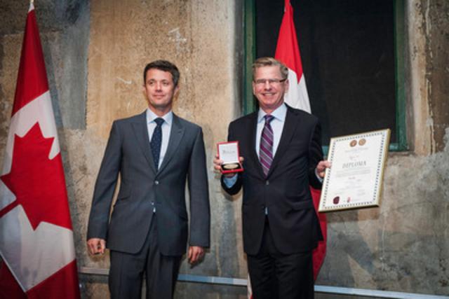 HRH Crown Prince Frederik of Denmark presents the prestigious export award to ROXUL President, Trent Ogilvie. Photographer: Robert McGee (CNW Group/Roxul Inc.)
