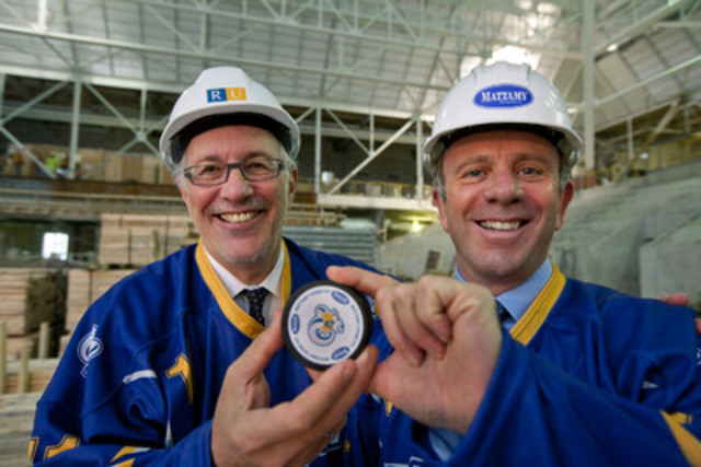 Sheldon Levy, President of Ryerson University (left), and Peter Gilgan, Founder and CEO of Mattamy Homes, proudly display a hockey puck emblazoned with logos of the Ryerson Rams and Mattamy Homes. Ryerson announced today that the athletic centre will be known as The Peter Gilgan Athletic Centre at the Gardens and the rink will be known as Mattamy Home Ice. (CNW Group/Ryerson University)