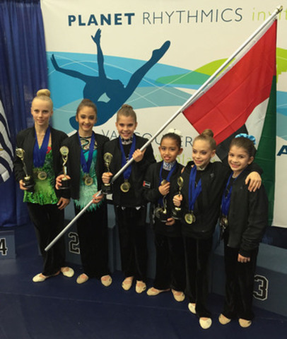 03/29/15 - Vancouver, BC. DuGym of UAE won 14 Gold, 6 Silver and 1 Bronze at the Planet Rhythmic Gymnastics Invitational. Pictured: Inka Viita, UAE National Shaikha Al Tayer, Chloe Young, Sona Hemagova, Abigail Scalon, and Evin Young. Shaika Al Tayer is breaking new ground for UAE women in sport. (CNW Group/DuGym Rhythmic Gymnastics)