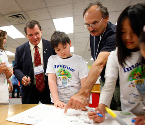Students from Connaught School let their imaginations run wild while learning to draw with award-winning illustrator Dusan Petricic, right, and Frank McKenna, Deputy Chair, TD Bank Group, left, to celebrate the national launch of the TD Summer Reading Club at the Calgary Public Library. (CNW Group/TD BANK GROUP)