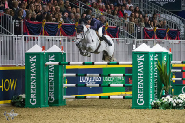 Mac Cone, of King City, ON, earned the $100,000 Greenhawk Canadian Show Jumping Reserve Championship title for the second year in a row riding Gasper van den Doorn on Saturday, November 5, at the Royal Horse Show. Photo by Ben Radvanyi Photography (CNW Group/Royal Agricultural Winter Fair)