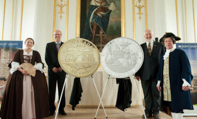 From left to right: Royal Canadian Mint Board of Directors member Kirk MacRae and Parks Canada Field Unit Superintendant (Cape Breton) Chip Bird unveil new gold and silver collector coins honouring the 300th anniversary of the founding of Louisbourg at the Fortress of Louisbourg National Historic Site in Cape Breton, Nova Scotia (June 4, 2013). (CNW Group/Royal Canadian Mint)