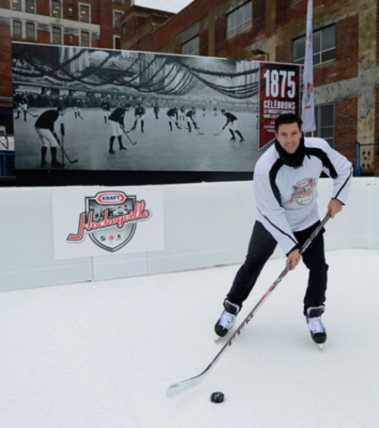 Hockey paradise put up in a parking lot: former NHLer Patrice Brisebois helps kick off Kraft Hockeyville 2014 at the former site of Victoria Skating Rink in Montreal. The program's back and bigger than ever offering a million dollars to 16 different communities across Canada. (CNW Group/Kraft Hockeyville)