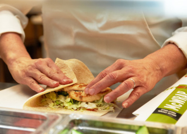 It's a wrap: Anne Parks, Director of Menu Management at McDonald's® Canada, wraps up a new Signature McWrap® with grilled chicken, shredded lettuce and cucumber in a warm whole wheat tortilla. (CNW Group/McDonald's Restaurants of Canada Ltd.)