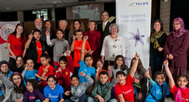 C'est à Polytechnique Montréal, en compagnie d'une classe de 5e année de l'École Henri-Beaulieu, de membres de Folie Technique et de la Chaire Marianne-Mareschal que le comité d'investissement communautaire de TELUS à Montréal a remis un don de 30 000 $ pour le projet Magnifiscience en classe. (Groupe CNW/FONDATION DE POLYTECHNIQUE)