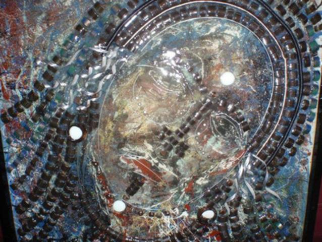 Technique mixte sur toile de Richard Desrosiers intitulée Visage, 30 X 30 pouces. (Groupe CNW/Sûreté du Québec)
