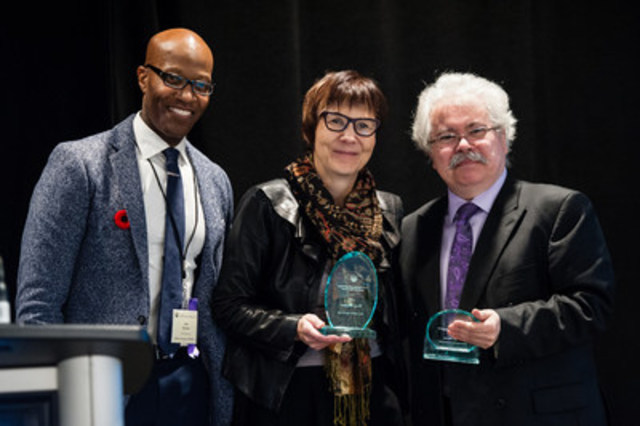 Keith Adamson (OASW President) presenting awards to Cindy Blackstock and Daniel Poulin (Photo credit: Nancy Kim) (CNW Group/Ontario Association of Social Workers)