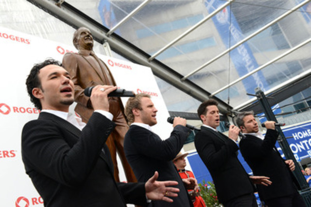 Multiplatinum singing group The Tenors perform at a ceremony at Rogers Centre in Toronto to unveil a bronze statue of the late Canadian business visionary, Ted Rogers. (CNW Group/Rogers Communications Inc.)