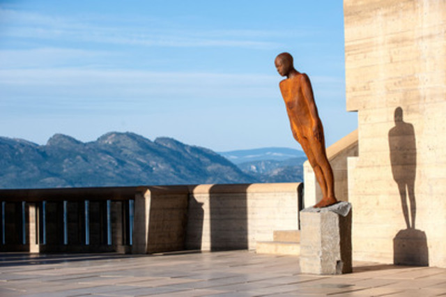 """The icon 'Encounter' corten sculpture leans precariously on a base of Icelandic granite at the base of Mission Hill's 12-story bell tower. Sculpture Name: """"Encounter"""" (CNW Group/Mission Hill Family Estate)"""