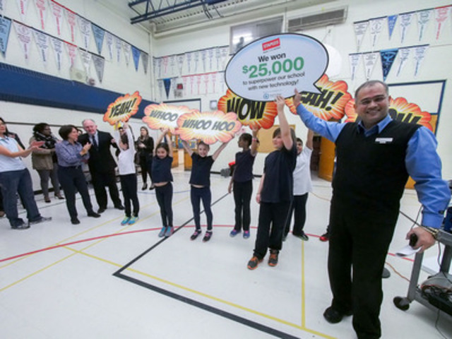 Syed Raza (right), manager of the Scarborough South Staples store along with students at St. Agatha Catholic School reveal to teachers and students that they won $25,000 worth of technology from Staples Canada. (The Canadian Press Images) (CNW Group/Staples Canada Inc.)