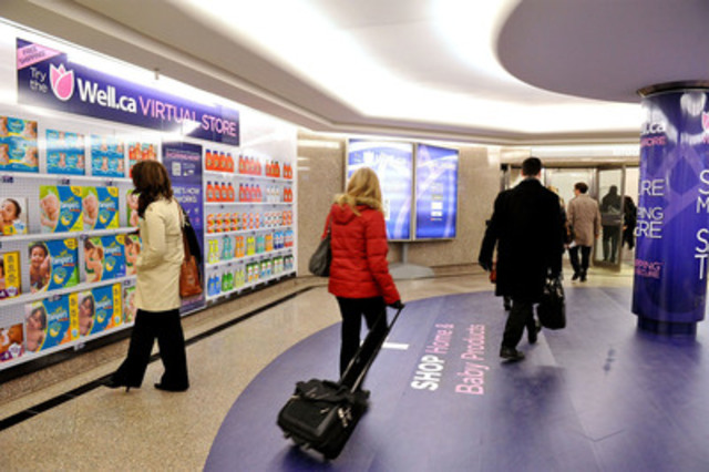 Commuters browse Canada's first virtual store in downtown Toronto. (CNW Group/Well.ca)